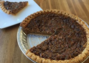 "Impress your holiday guests this holiday season with Chef Chad's spectacular Brown Butter Pecan Pies made from an old family recipe. This pie has been a house-favorite dessert since we opened in March. Burlingame is offering whole 9"" Pecan Pies for Thanksgiving for just $20 + tax. Orders can be placed by calling 904-432-7671. Leave your name, phone number and number of pies you would like to purchase. We will call back to confirm the order and obtain pre-payment information. Pick-up will be at the restaurant (20 South 5th Street in Fernandina Beach) on Wednesday 23 November between 10:00 am and 4:00pm."
